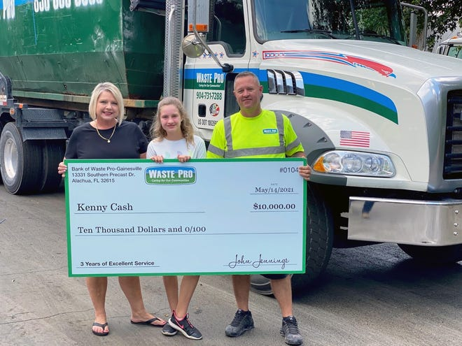 Waste Pro employee Kenny Cash, right, was awarded the company's $10,000 Safety Award. [Submitted photo]