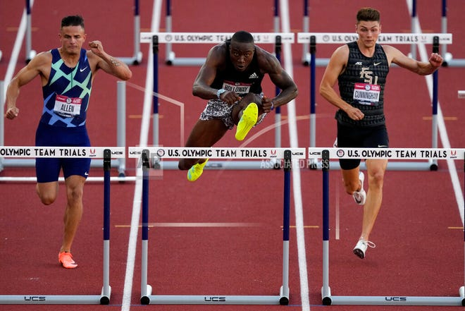 Winfield's Trey Cunningham, far right, placed fourth in the men's 110 hurdles final at the US Olympic Track and Field Trials on Saturday, June 26 in Eugene, Oregon, making him an alternate for the US team. Devon Allen (left) finished second and will make his second Olympics appearance while former University of Florida athlete Grant Holloway (center) placed first in the final (12.96) to qualify for the US team. (AP Photo/Charlie Riedel)