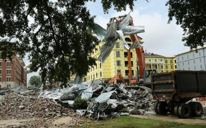 Demolition of the Julia Tutwiler Hall on the University of Alabama campus has begun as workers are removing debris from the annex behind the building Friday, July 2, 2021. [Staff Photo/Gary Cosby Jr.]