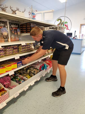 Boaz Raderschadt of Lew's Fireworks stocks shelves in preparation of the Fourth of July festivities. Lew's is hosting a special fireworks show involving the public on the Fourth of July.