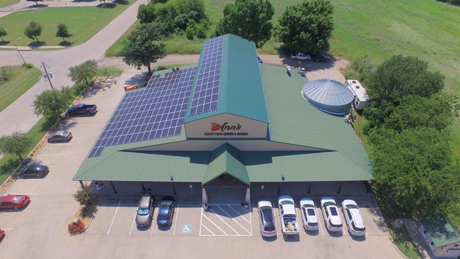 An aerial view of Ann's Health Food Center & Market in Waxahachie with almost 200 newly-installed solar panels on its roof.