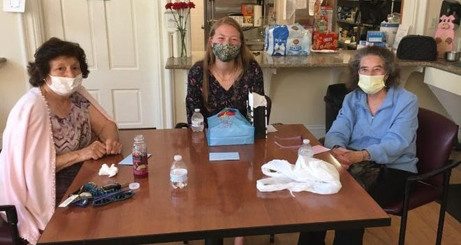 Hudson High School senior Faith Harlow, in center, of the school's Interact Club, met her pen pals, Marie Bentley, left, and Hazel Hodgins, on June 13 at the Hudson Senior Center after corresponding by letter throughout the pandemic months.