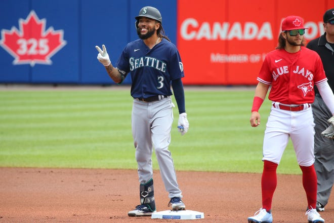 Seattle's J.P. Crawford celebrates after hitting a double in Thursday's win against Toronto. Crawford is among the young Mariners providing some hope for a team that's overachieved through the first half of 2021.