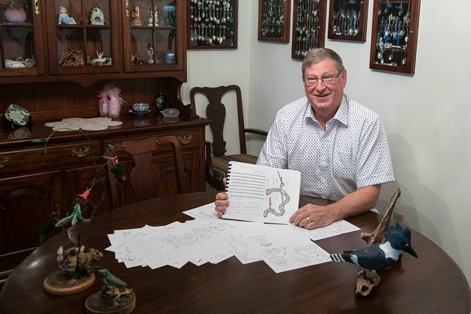Chillicothe City teacher Steve Maybriar shows off drawings he made of SpongeBob to illustrate science lessons that were used while he was a teacher. Maybriar is retiring after 30 years as a teacher.