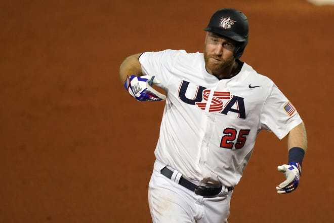 Team USA third baseman Todd Frazier (25) points to his chest while he rounds the bases after hitting a solo homerun in the 7th inning against Venezuela in the Super Round of the WBSC Baseball Americas Qualifier series at Clover Park in June.