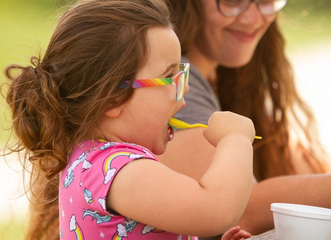 Four-year-old Kiera Timbehrski eats Blue Moon ice cream, accompanied by mom Jessica, at Cap'n Frosty Ice Cream in Hamburg Friday, July 2, 2021.