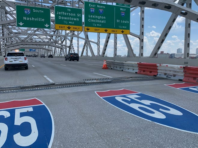 """""""Finger joint weights"""" on the Kennedy Bridge each weigh about 1,000 pounds and are 1.5 inches thick, according to KYTC. These plates have been moved so that work crews repairing the bridge can view the expansion joint. The bridge is closed in the meantime. July 2, 2021"""