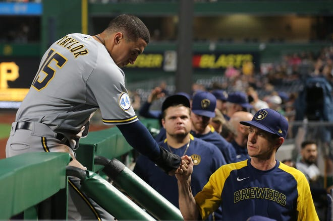 Brewers rightfielder Tyrone Taylor gets a fist bump from manager Craig Counsell after scoring a run against the Pirates during the sixth inning.