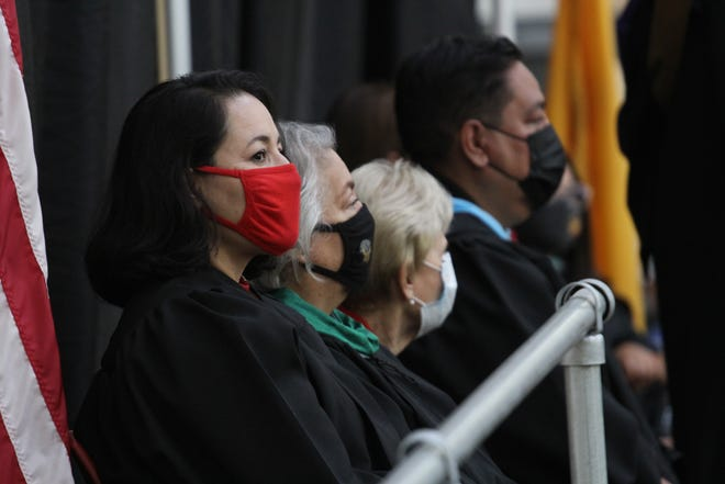 From left to right, school board members Teresa Tenorio, Maria Flores, Carol Cooper and Ray Jaramillo attend the Las Cruces Public Schools graduation ceremonies for the summer Class of 2021 and the Class of 2020 at Centennial High School on July 1, 2021.