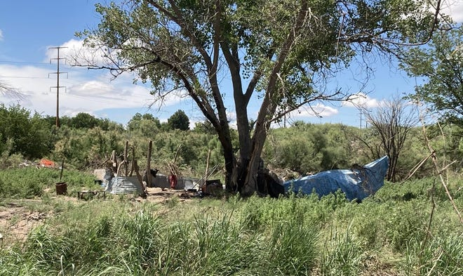 A homeless encampment was destroyed after the Lower Transill Dam overflowed in Carlsbad, New Mexico. Residents of the camp say they had just minutes to evacuate before their belongings were swept away by the flood.
