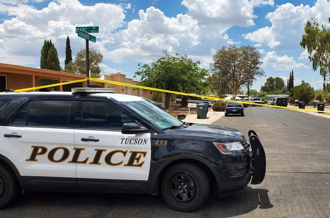 Members of the Tucson Police Department on scene investigating a triple homicide on East Toronto Street.