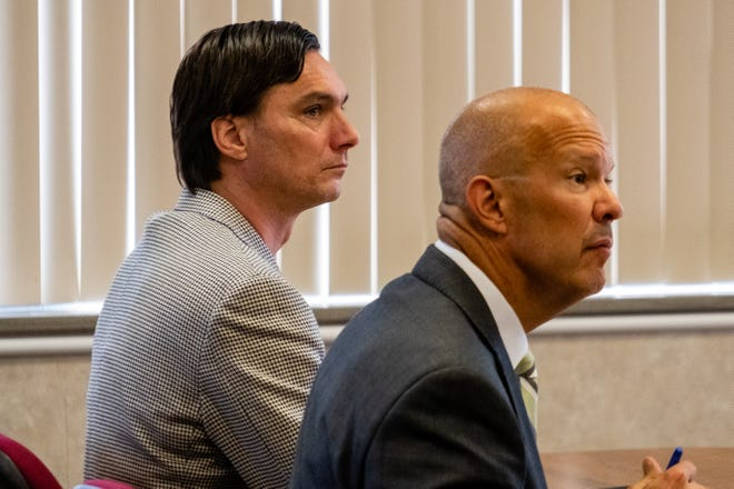 John Varndell Jr., left, sits next to his attorney, MIchael Boucher, as the verdict is read during his trial Friday, July 2, 2021, in the St. Clair County Courthouse in Port Huron. Varndell was found guilty on all charges for shooting and killing his 11-year-old stepson.