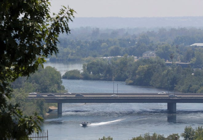 A smoky haze hangs over Redding in this view of the Highway 44  bridge over the Sacramento River from River Bend Road. Smoke from the Salt Fire north of Redding and other North State fires is blanketing Shasta County, resulting in health advisories.