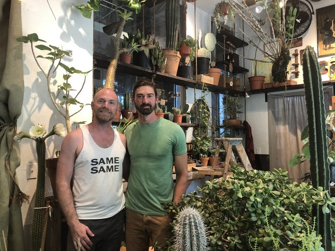 Owner of the Deku Tree, Joshua Cooper (right), at his new store located at 421 N. Phillips Ave.