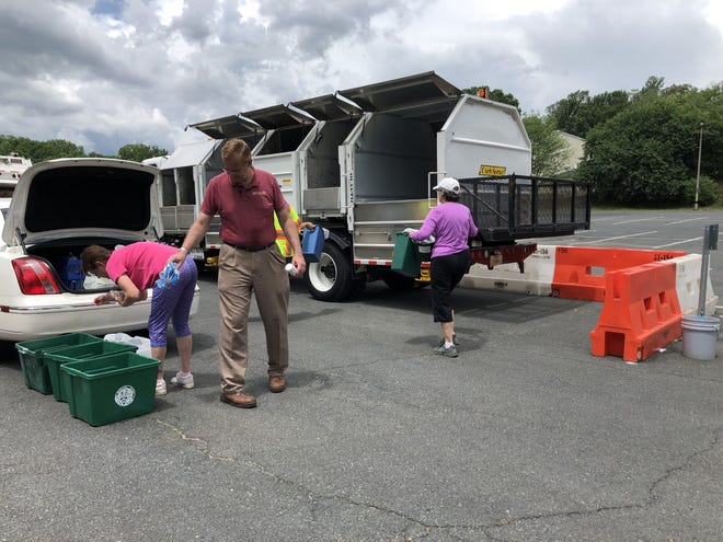 Public works employees help residents get their material sorted and taken to the bins if needed.