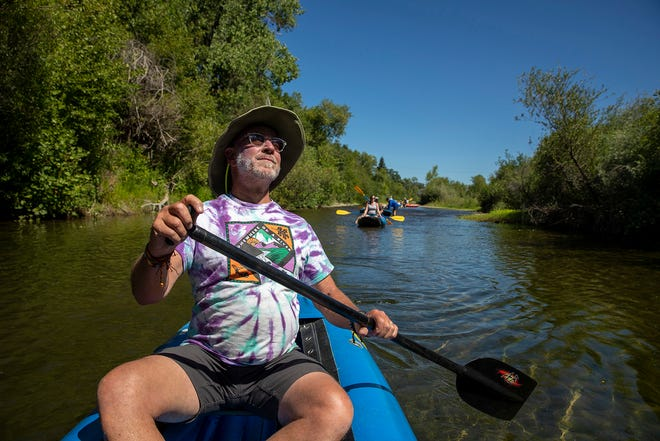Larry Laba, owner of Russian River Adventures, paddles down the Russian River in Healdsburg.