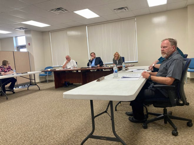 Maysville Board of Education member Kerry Hartman discusses the board's vote at an open meeting on Thursday, July 1, 2021. A public hearing was held.