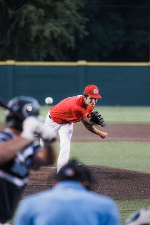 Kaleb Melvin delivers a pitch for the Oklahoma Mudcats during Friday night Winget tourney play against the Three Rivers Bandits. The Mudcats won in nine innings. (Andy Dossett/Examiner-Enterprise)