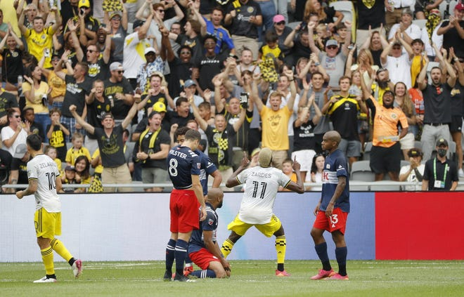 Fans celebrate a goal by Crew forward Gyasi Zardes on Saturday. Zardes has left to join the U.S. national team and might be gone until Aug. 1