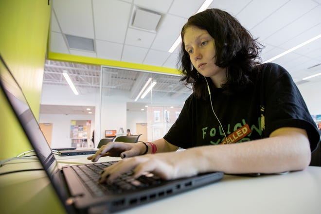 Stevie Bentley, 15, works on homework in the Parsons Branch of the Columbus Metropolitan Library. She said that getting help through its Credit Recovery Center has been invaluable this summer.