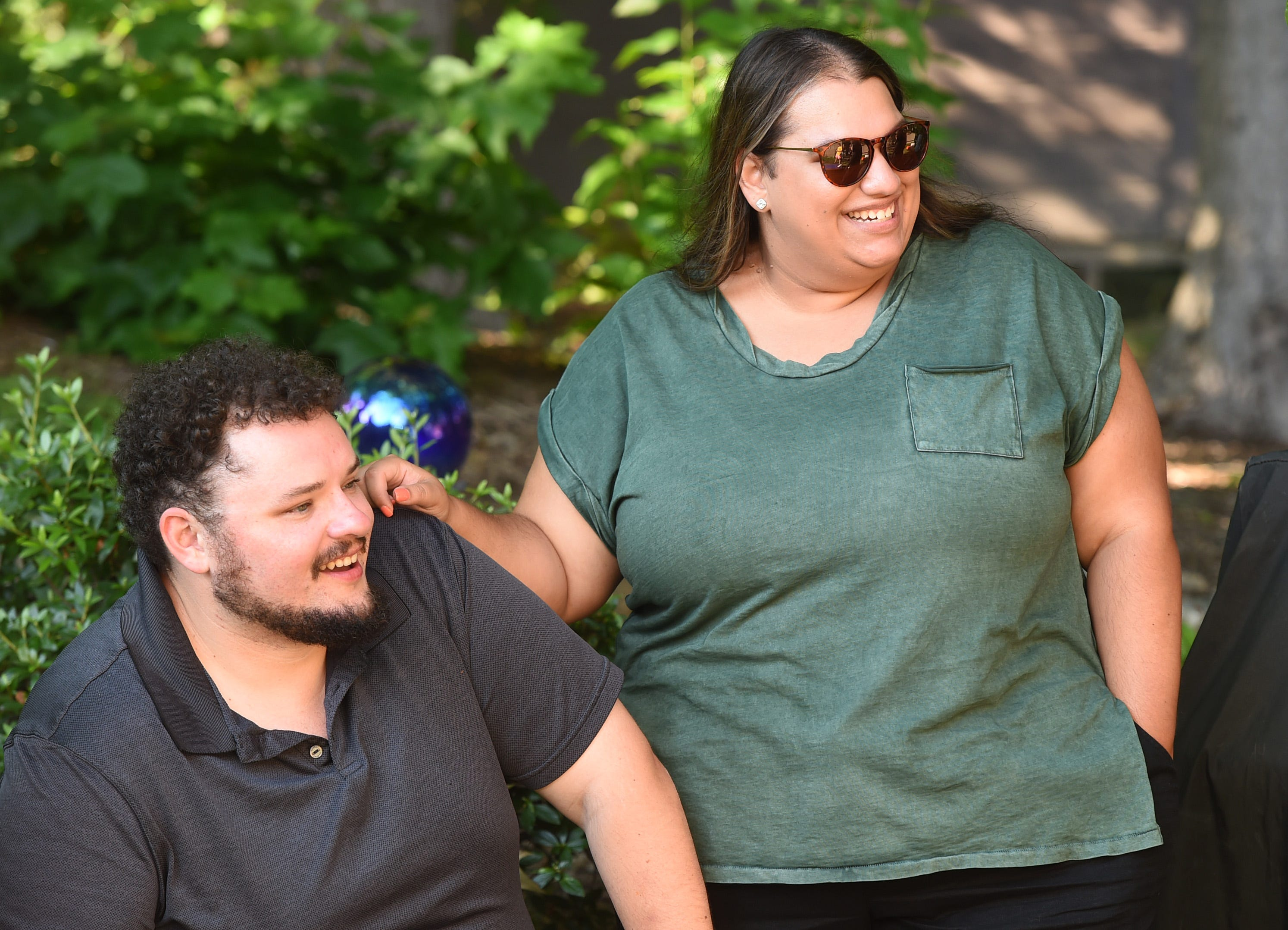 Recently married, Theresa Walker of Erie and her husband, Ethan Walker, attend a family gathering July 3 in Millcreek Township.