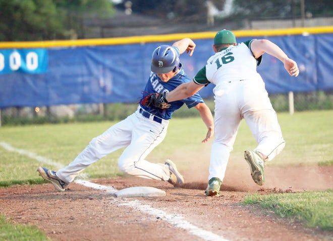 West Burlington's Hayden Vandenberg tags Danville's Grifen Molle for the out at third base Friday night at Danville.