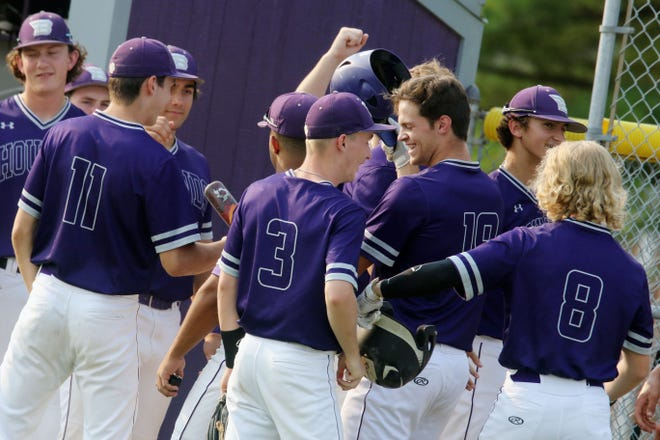 Burlington High School's Jacob Zahner (19) is congratulated by teammates after hitting a two run homer during the first game of their double header against Mount Pleasant High School Friday July 2, 2021 at BHS.