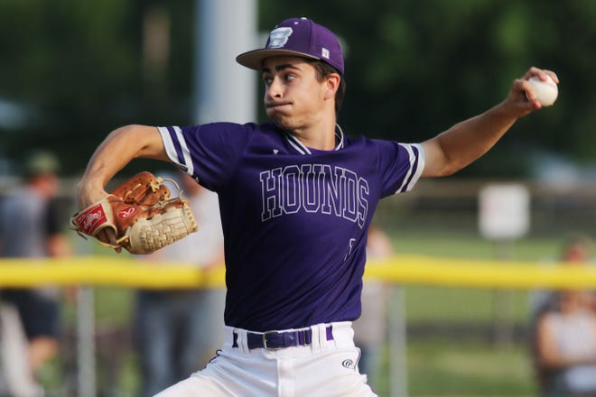 Burlington High School's Brendon Hale (1) delivers a pitch during the first game of their double header against Mount Pleasant High School Friday July 2, 2021 at BHS.