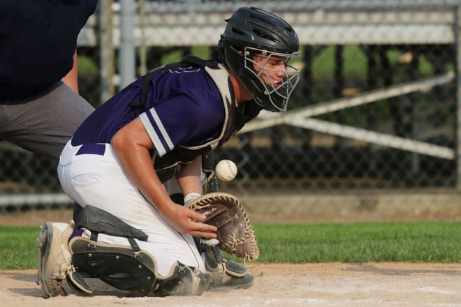 Burlington High School's Daniel Remele (17) stops a wild pitch during the first game of their double header against Mount Pleasant High School Friday July 2, 2021 at BHS.