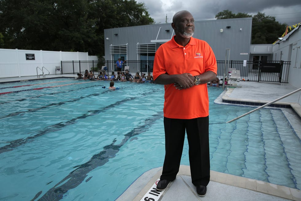 Jacksonville City Council President Sam Newby stopped at the Johnson Family YMCA on his first day as council president. The YMCA is a short distance from his childhood home so he went there often while growing up and later served as chairman of its board before running for council. He is wearing an Edward Waters University shirt for his alma mater.