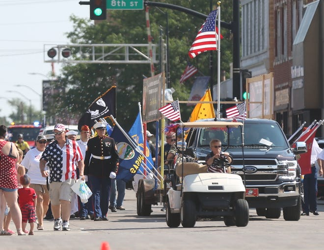A float representing the United State Marine Corps makes it way down Main Street during the Wild West Festival Parade on Saturday morning.