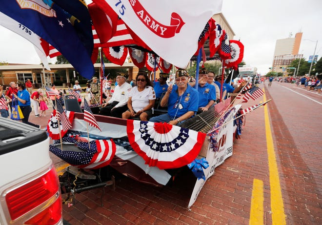 Members of the VFW Post 2466 ride in their float during the 31st annual 4th on Broadway Independence Day parade and festival Saturday, July 3rd, 2021. (Mark Rogers/For A-J Media)