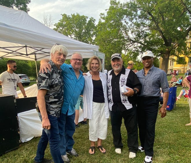 Tally Gwynn (center) along with the four members of the country and classic rock band Tailor Made, which performed at Granger Homestead in Canandaigua for the museum's first summer concert in June. The museum will host two more concerts this year, in July and August.