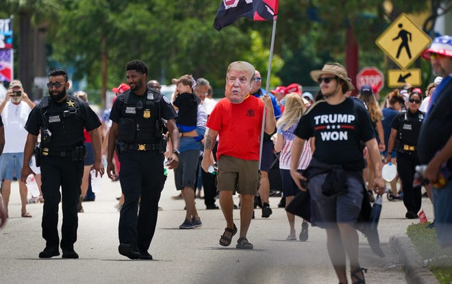 Wearing a cutout of Donald Trump's face, Jeff LeBaron of Bradenton attends a rally for former President Donald Trump at the Sarasota Fairgrounds on July 3, 2021. DANIEL WAGNER / HERALD-TRIBUNE