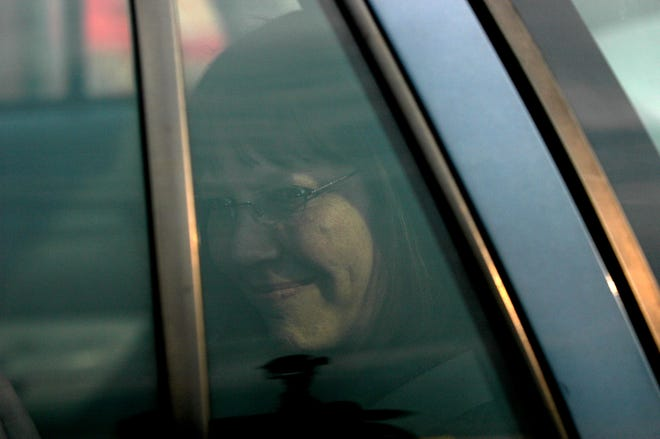 New York Times reporter Judith Miller looks out the window of a police car at the entrance of the Alexandria Detention Center on July 6, 2005, in Arlington, Virginia. A federal judge on Wednesday jailed Miller for refusing to divulge her source to a grand jury investigating who in the Bush administration leaked an undercover CIA operative's name.