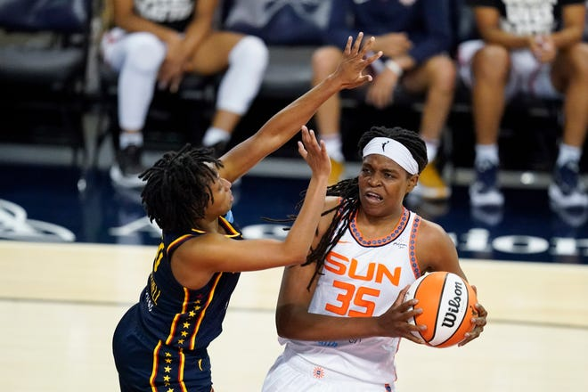 Connecticut Sun's Jonquel Jones (35) goes to the basket against Indiana Fever's Kelsey Mitchell (0) during the first half Saturday in Indianapolis.