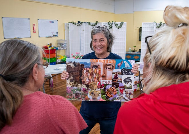 Marie Bugbee shows off her completed collage during an art class July 2 at Opening the Word Peer Recovery Center.