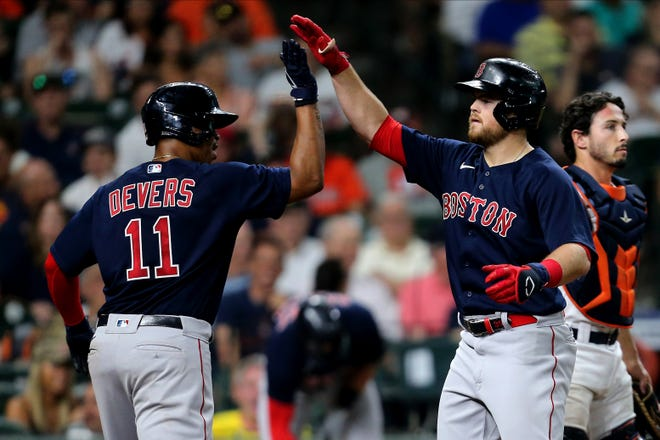 """""""He's also an unbelievable teammate,"""" Christian Arroyo, right, says of American League All-Star Game starting third baseman Rafael Devers, """"and he's just a big kid having fun."""""""