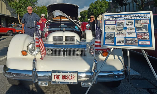 """Rusty Poole poses for a photo July 2 with his """"Ruscar"""" during Downtown Gadsden's First Friday. Poole made the one-of-a-kind car with his father."""