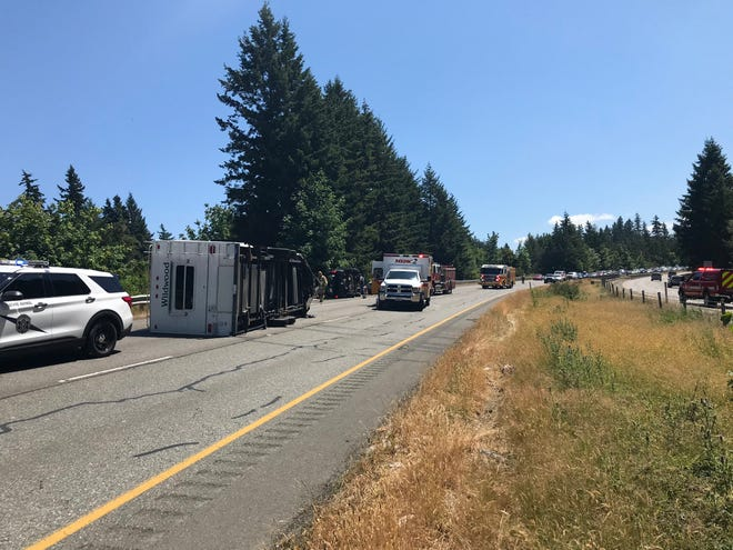 An SUV and a trailer overturned on Highway 3 Saturday afternoon.