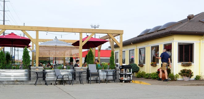 Dinner is served on the new patio at Nellie's Restaurant  in Newburgh, Ind., on Friday, July 2, 2021.