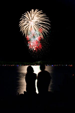 People gather at Sellers Point on Buckeye Lake for the annual fireworks display on Thursday night.