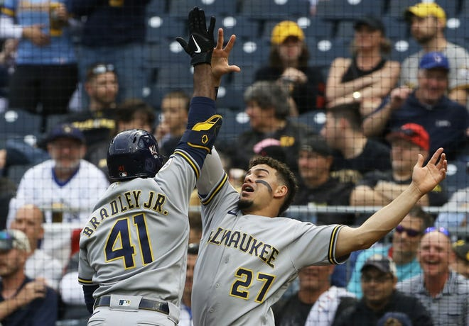 Jackie Bradley Jr. celebrates his solo home run with Willy Adames during the second inning as the Brewers went on to beat the  Pirates for their 10th straight victory.