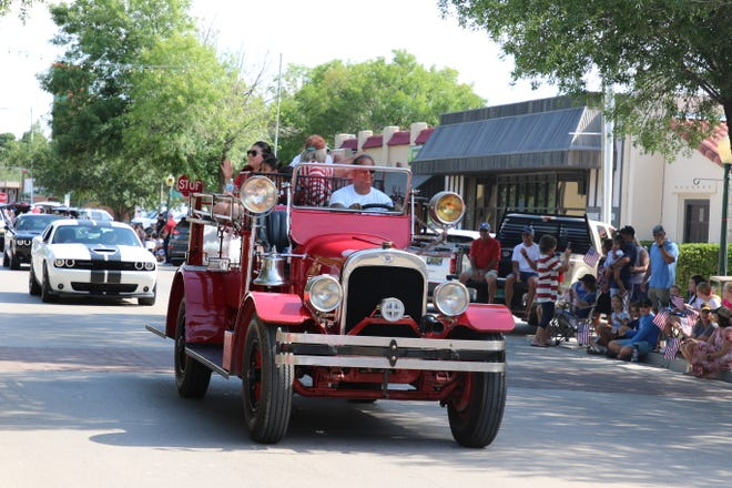 Carlsbad Fire Chief Richard Lopez drives an antique fire engine in Carlsbad's Independence Day parade on July 3, 2021.