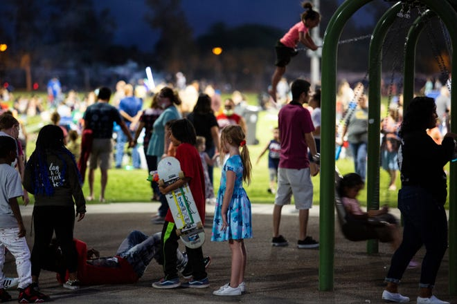 People gather at Mission Springs Park to watch the fireworks show in Desert Hot Springs, Calif., on July 2, 2021.