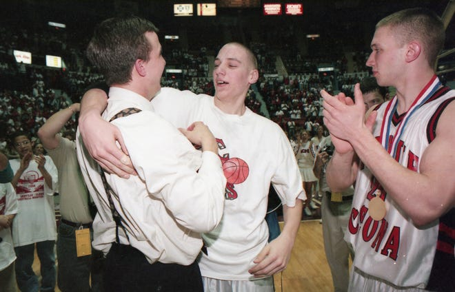 Annville-Cleona head basketball coach Scott Pera gets a hug from Mark Linebaugh after the Little Dutchmen defeated Quaker Valley 69-57 in double overtime for the PIAA Class AA state championship in 1999.