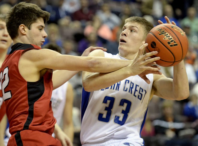 Cedar Crest's Evan Horn drives to the hoop agianst Cumberland Valley's Collin Schutjer during the quarterfinal District 3 AAAA game at the Giant Center on Saturday, Feb. 22, 2014. Crest won the game 47-35.