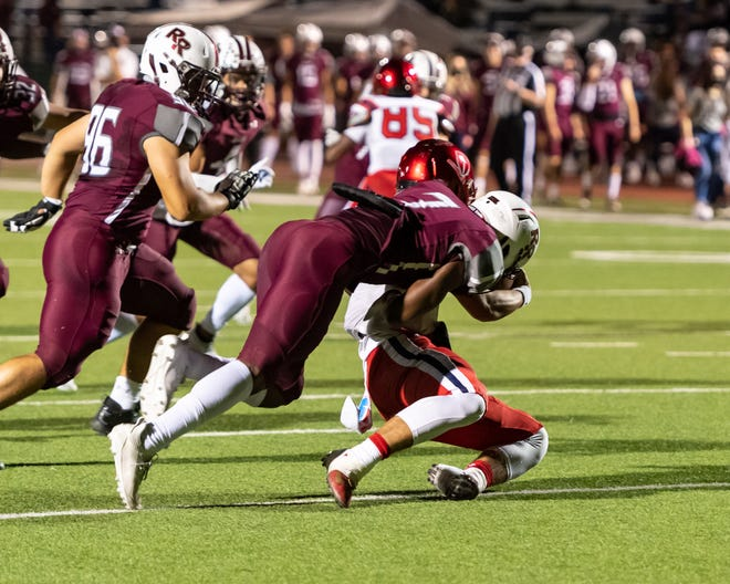 Travien Brown of Round Rock sacks Cornerstone Christian quarterback Lucas Coley near his own goal line in  nondistrict game last season. Brown, a 6-2, 220-pound senior, headlines the Dragons' defensive line after a second-team, all-district campaign that included 43 tackles, 8.5 sacks and 5.5 tackles for a loss from his defensive end spot.