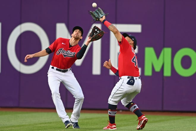 Cleveland's Bobby Bradley, right, avoids colliding with outfielder Bradley Zimmer to catch a ball hit by the Houston Astros' Taylor Jons in the fourth inning of the Astros' 3-2 win Saturday night at Progressive Field. [David Dermer/Associated Press]