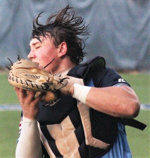 Hunter Harlan hauls in a pop fly during Bartlesville Doenges Ford Indians' action in the Winget tourney.